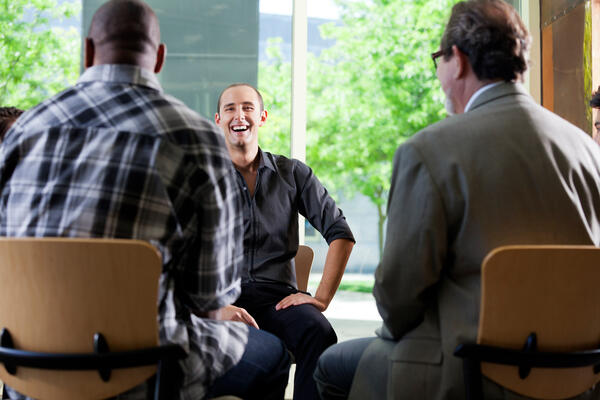 Mens therapy group seated in a circle